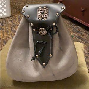 Gray and black belt bag.